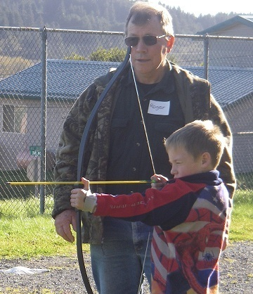 Roger Smith teaches archery to the After School Program