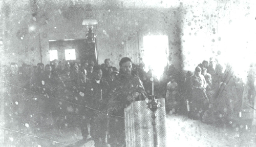 Afognak-Father-Gerasim-in-church.jpg
