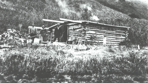 Bauman-&-Sticklers-cabin,-Mr.-and-Mrs.-Benson-on-left.jpg
